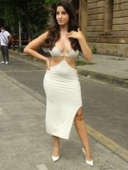 Actress Nora Fatehi Sizzling White Dress 11