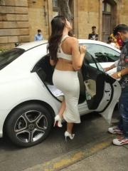 Actress Nora Fatehi Sizzling White Dress 9